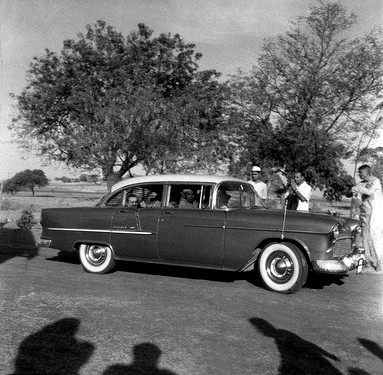 Meherabad, India - Feb.1958 ; Meher Baba in the rear of Meherjee's car, with Kumar in the front with the driver. Photo taken by Meelan