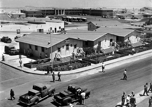 A view of the Dhahran  Headquarters Office Building  is in the background, 1952
