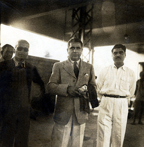 Picture taken by Ivy Duce at the Poona Railway Station on 12 January 1948. Eruch Jessawala ( right ) Adi K. Irani ( centre ) & Dr. Ghani  ( left with sunglasses ).