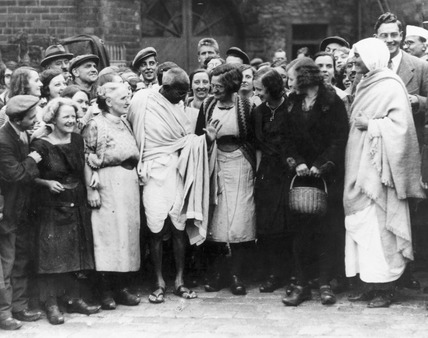 Gandhi with cotton mill workers  in Central England