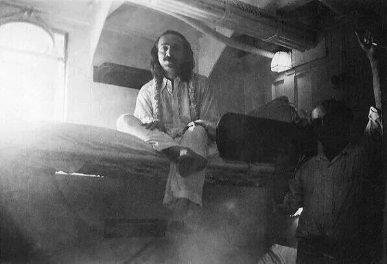 Meher Baba in his cabin with Kaka Baria. Ship is unknown. Full image.