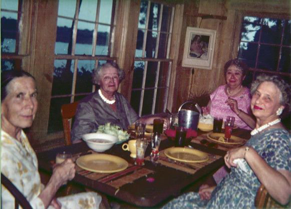 Original Kitchen, Meher Center, probably in the 1960s. — (L-R) Kitty Davy, Elizabeth Patterson, Murshida Ivy Duce and Laura DeLavigne