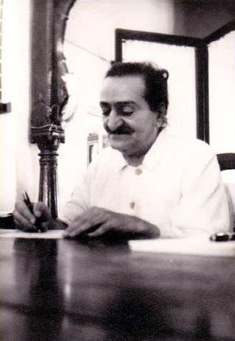 Meher Baba signing copies in Satara in early 1955