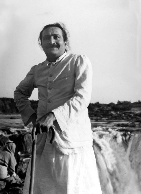 Meher Baba next to the Dhuandhar Falls on the Narmada River near Jabalpur. Courtesy of MN Publ.