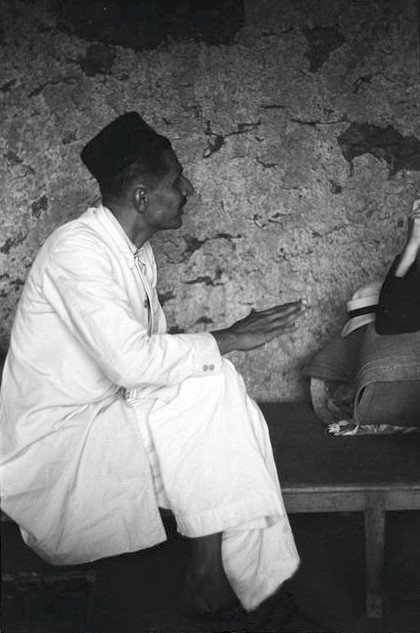 Dec.1938 ;Pleader talking to Hedi Mertens inside the Panchgani Cave, India. Walter Mertens photographer. Courtesy of MN Collection.