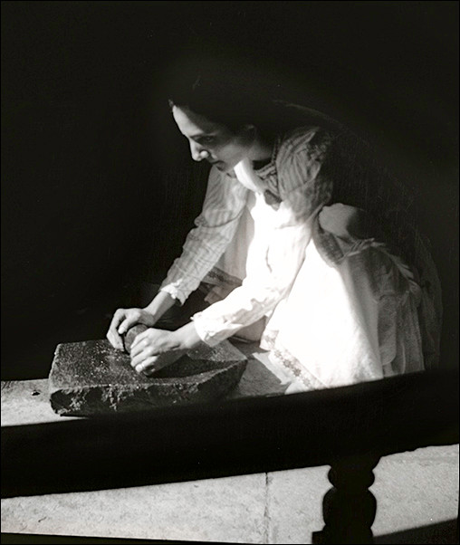Mehera using her grinding stone set, mid-1930s
