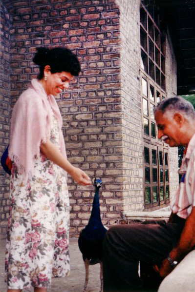 Bobbi feeding a peacock with Jal Dastoor in India