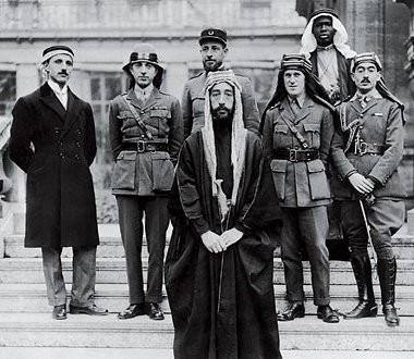 Interestly, Lawerence ( of Arabia ) is standing on the right of the Arabian king.