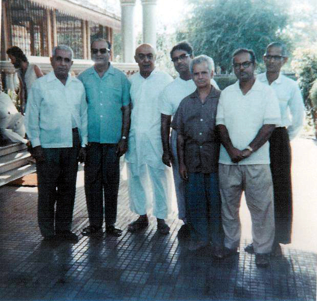 "Men Mandali at Guruprasad, Pune, India, 1969. ""Great Darshan""  ( L-R ) Adi, Nariman, Pendu, Eruch, Aloba, Bhau, & Bal. Photo taken by Sam Ervin"