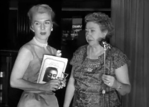 1956 ; Longchamps Restaurant, New York ; Marion with Ivy Duce