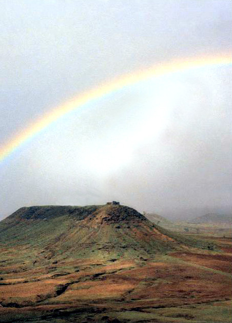 Rainbow over Khandoba Hill near Meherazad, India  - Photographed by Bill Reading