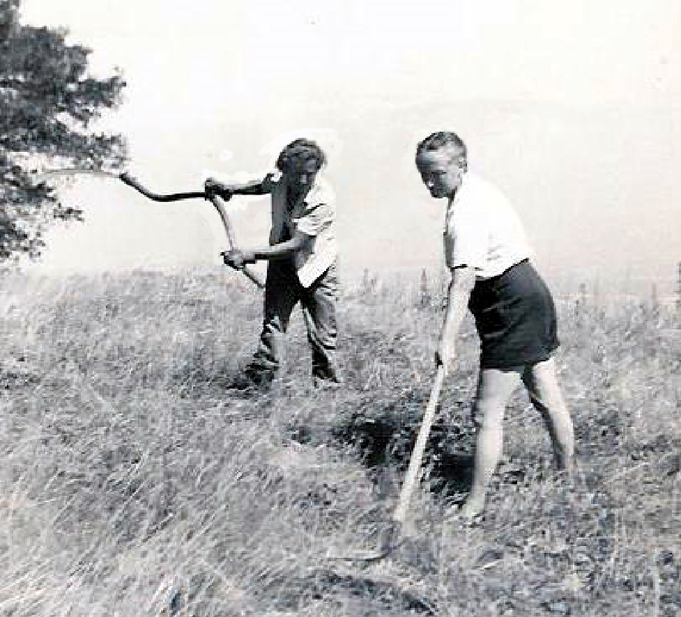 AGNES BARON (left), Meher Mount co-founder and lifetime caretaker, and Margaret Craske, a disciple of Meher Baba and ballet teacher from New York City, tackle the weeds during a month of silence in July 1949