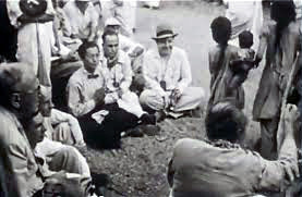 1954 , Meherabad, India ; Hitaka sitting with his hands together