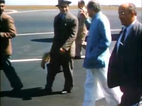 1956 : walking to the terminal ( L-R ) Eruch, Meherjee, Meher Baba Fred Winterwelt