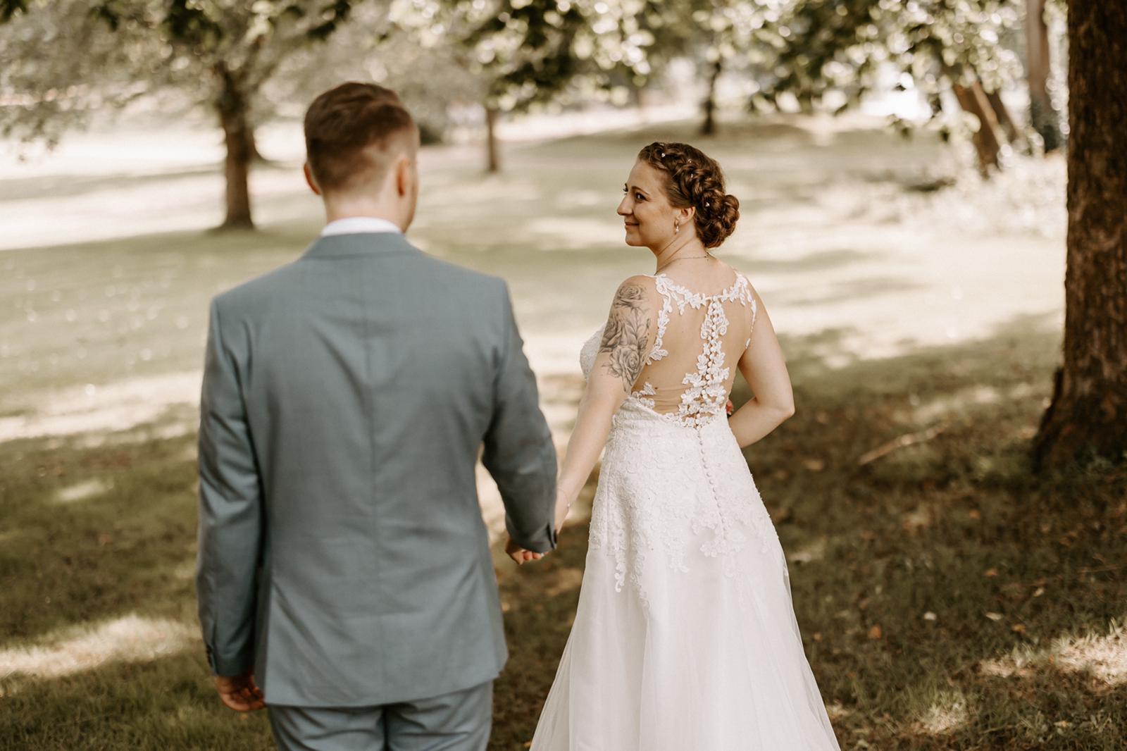 geflochtene mit Updo gestylte Brautfrisur Foto by Sara Eisenmann