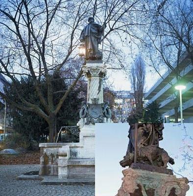 estatua del siglo XVI en Sttugarsd (Alemania) es un personaje de la epoca acompañado de un perro Schnauzer.