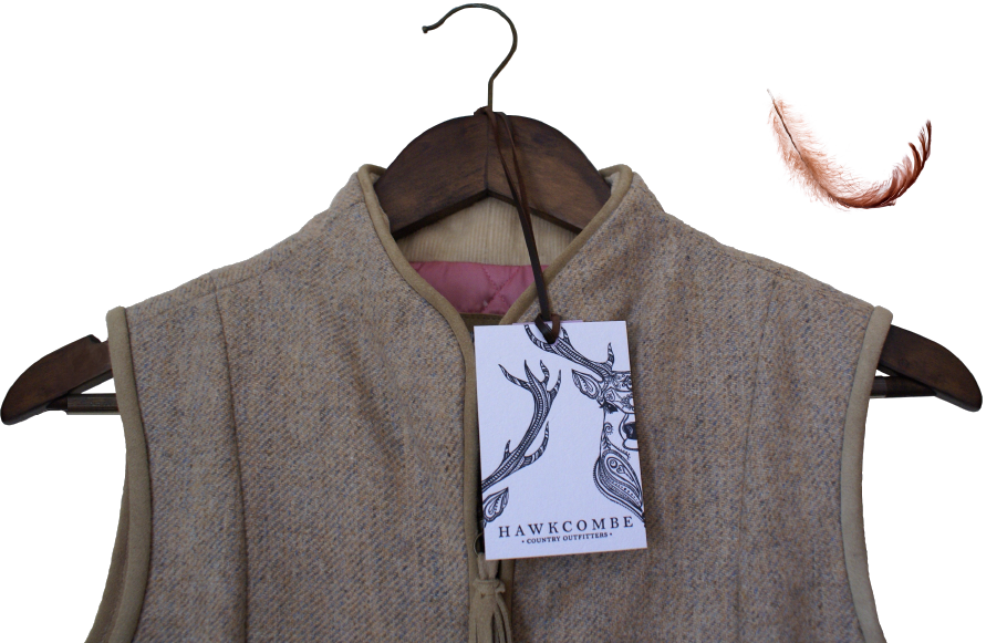 Close up of a Hawcome Counrty Outfitters beige  tweed gillet, by Design By Pie, Graphic Designer, North Devon