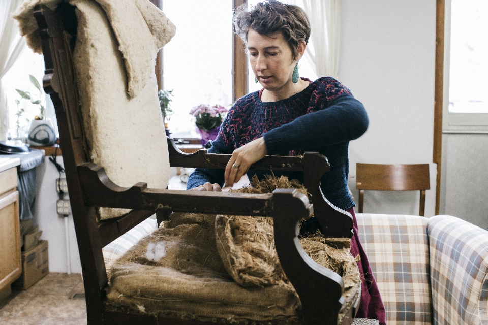 Julie working on a vintage chair. Photo by @anna_kimm_photography