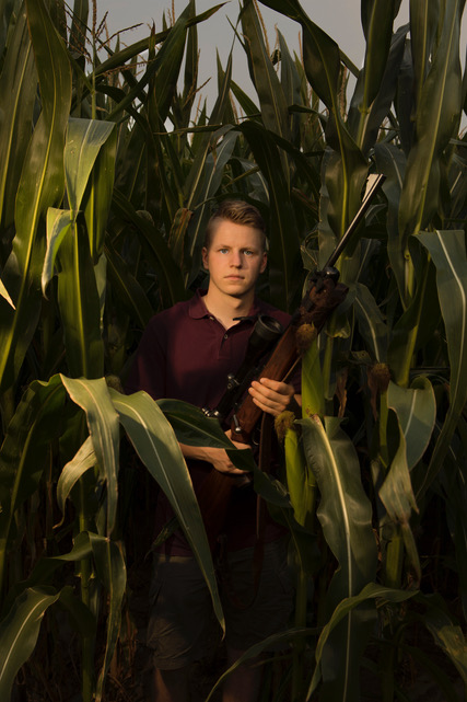 a young hunter in the corn hunts wild boars, which multiply greatly because of the corn.