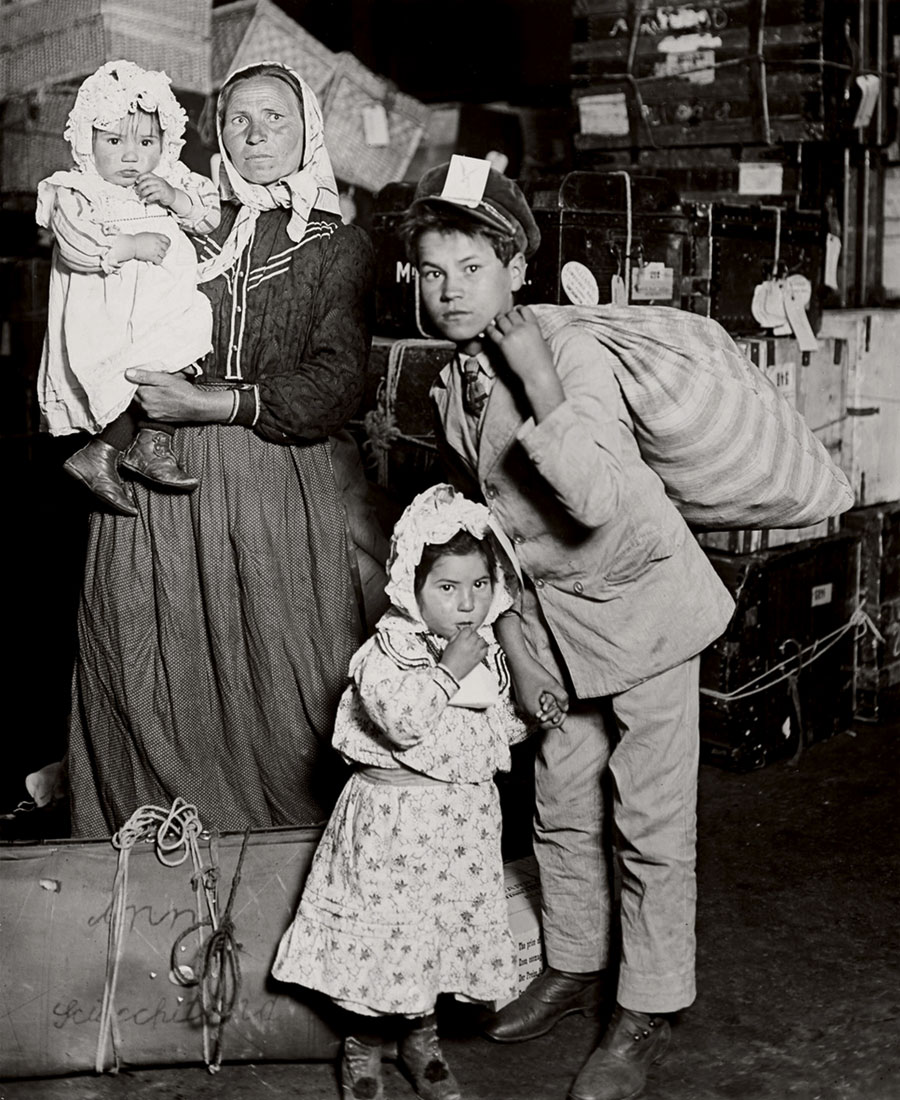 Italian Family Looking for Lost Baggage. Ellis Island (1905). L. Hine