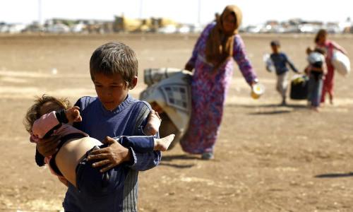 Una familia de kurdos sirios en Suruc (2014). Murad Sezer/Reuters
