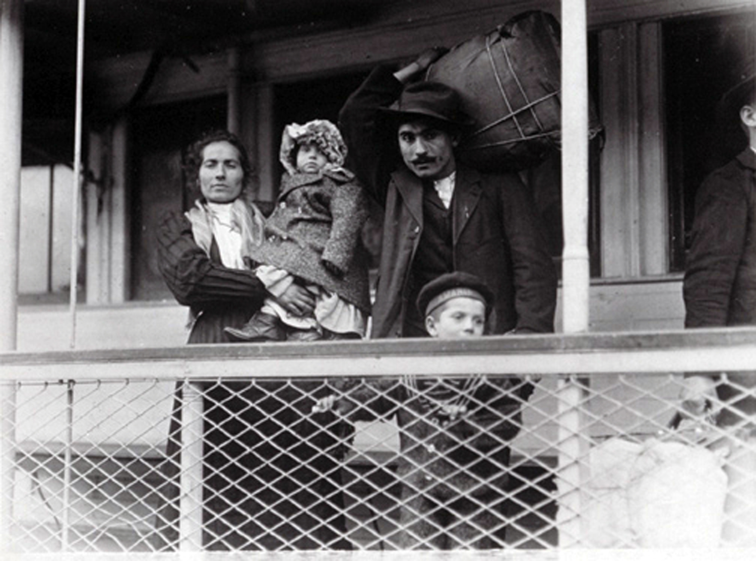 Italian Family on ferry boat. Ellis Island (1905). L. Hine