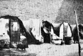 Huttes de mendiants sous les murailles de la ville