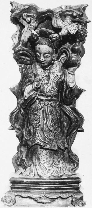 335. — Statuette en porcelaine ancienne, datant de l'époque des Ming.