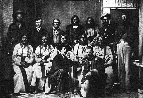 Black Kettle (seated center) and other Cheyenne chiefs conclude successful peace talks with Major Edward W. Wynkoop (kneeling with hat) at Fort Weld, Colorado, in September 1864.