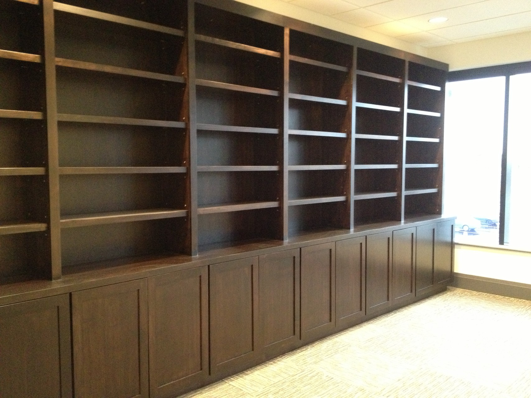 Custom Bookshelves - Stained and finished on site