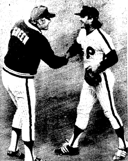 Tug McGraw shakes Dallas Green's hand after earning a save in the Game 1 victory.