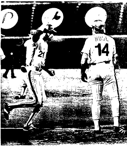 Bake McBride is congratulated by Pete Rose following his home run.