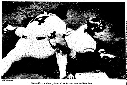 George Brett dives into first safely on a Carlton pickoff attempt.