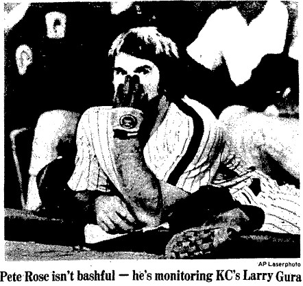 Pete Rose watching with interest from the dugout.