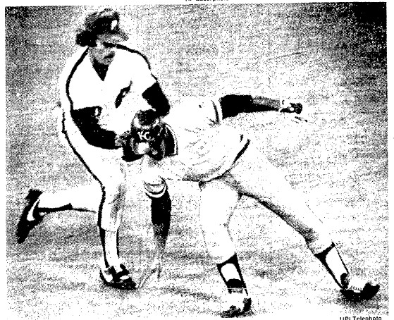 Amos Otis is tagged out by Mike Schmidt following a 7th inning rundown.