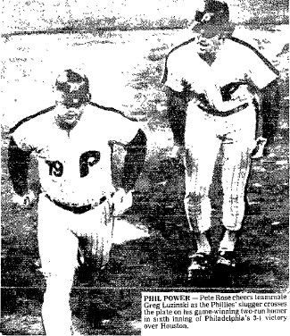Greg Luzinski crosses home and gets congratulated by Pete Rose.