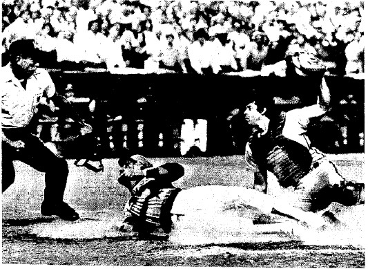 Bob Boone tags out Luis Pujols in the 2nd inning.
