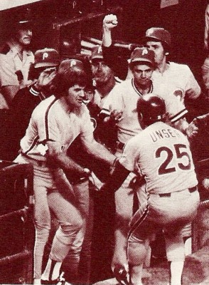 Del Unser is congratulated after scoring in the 10th.