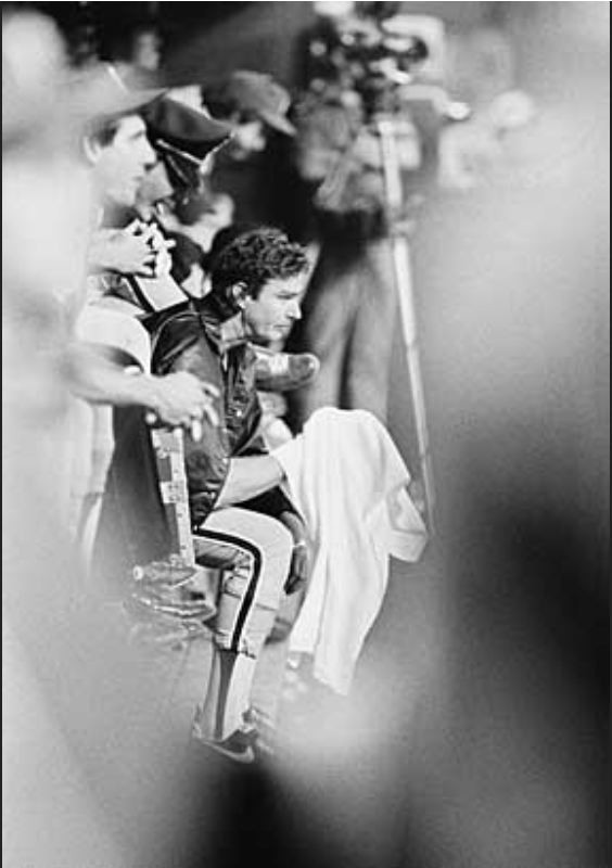 Steve Carlton looks on from the dugout in the sixth inning.