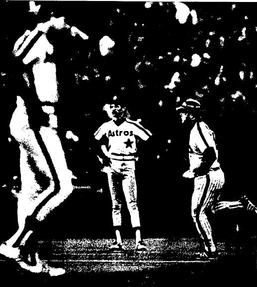 Houston's Bob Forsch looks down as Greg Luzinski begins his home run trot.
