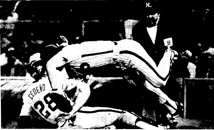 Pete Rose reaches for a pickoff throw from Steve Carlton that failed to get Cesar Cedeno.