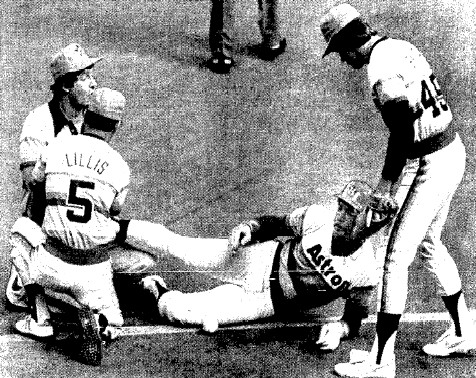 Cesar Cedeno lies in pain after injuring his knee in the 6th inning.