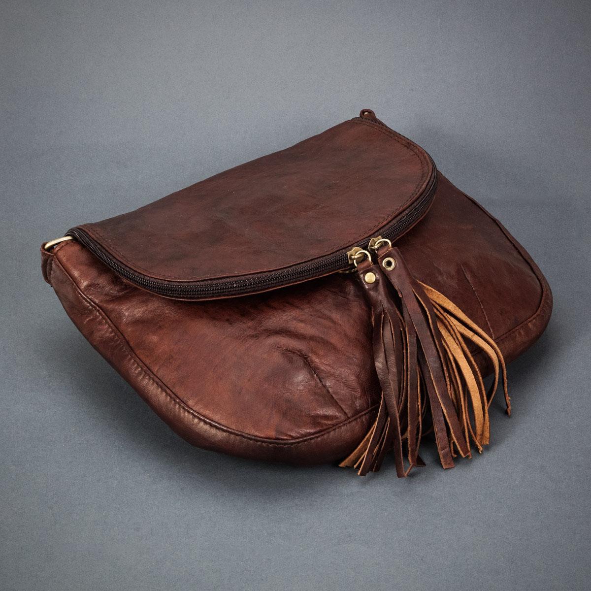 предметное фото женской сумочки из натуральной кожи