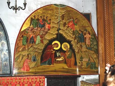 Icône murale surmontant la porte de l'escalier conduisant à la grotte vénérée sise sous le choeur de le Basilique.