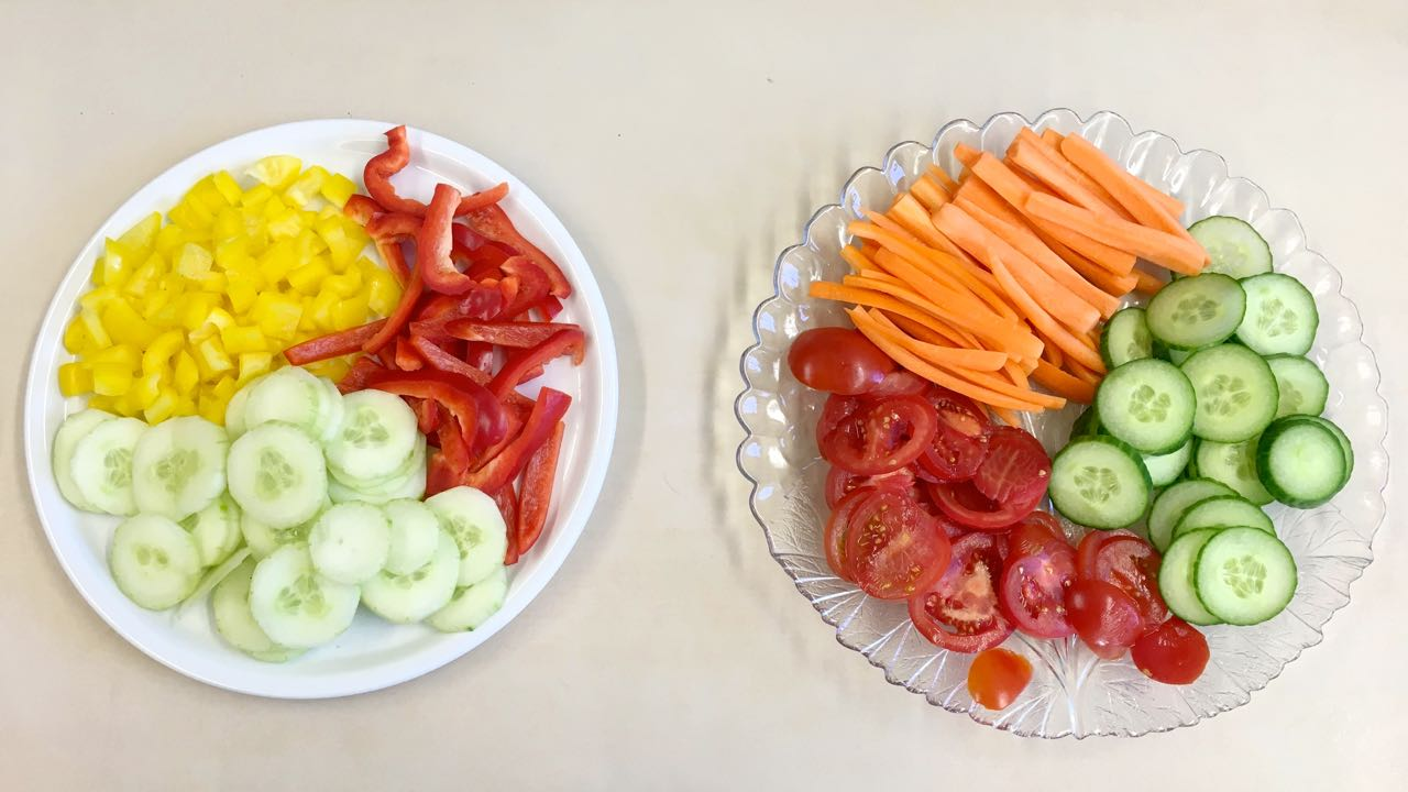 carrots, cucumbers, tomatoes and peppers,
