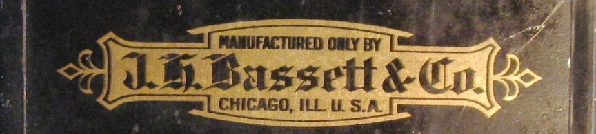 en el reverso: Manufactured only by J.H. Bassett & Co., Chicago, ILL. USA