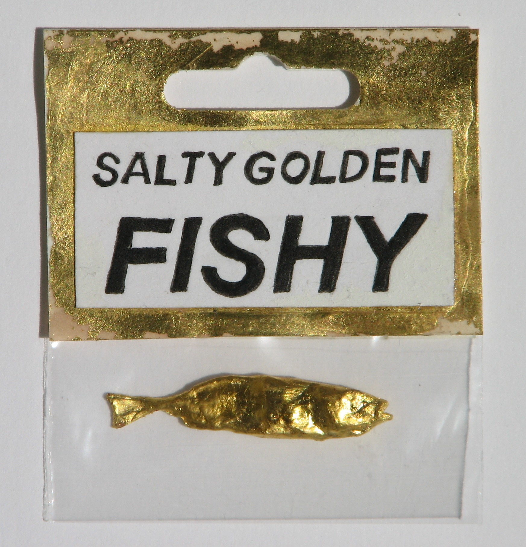 Salty Golden Fishy  2016  Gilt Fish in Packaging  4,6 x 1cm