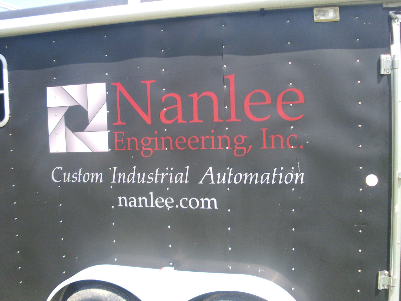 Nanlee Engineering Mobile Manufacturing trailer with name