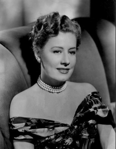A RECENT PORTRAIT of Irene Dunne, slim and gracious 46-year-old American actress, whose selection for the role of Britain's Queen Victoria brought forth a stream of criticism.