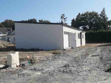 maison neuve de plain pied avec toit bac acier